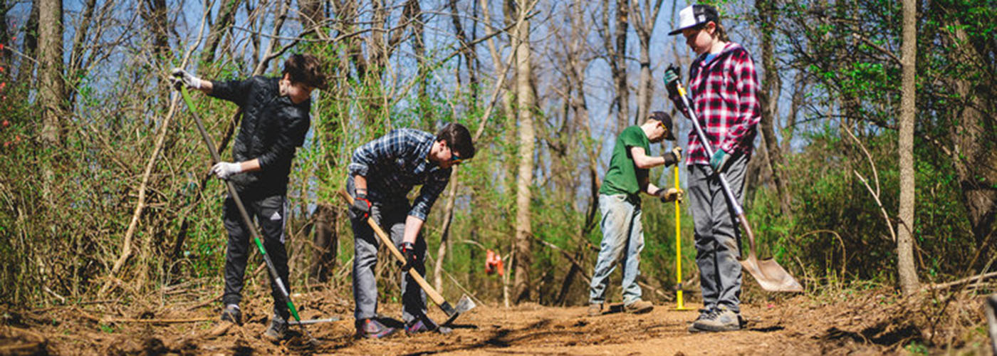 Volunteers, students, trail building, shovels, rakes