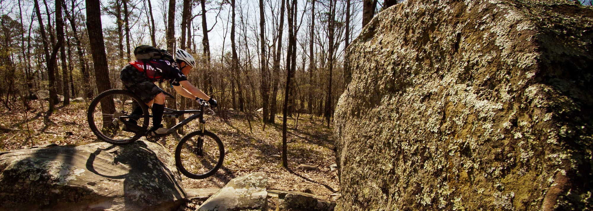 riding over mossy rocks